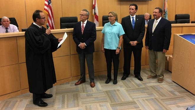 The four City Council candidates-elect - incumbent Larry Honig, Charlette Roman, Jared Grifoni and Howard Reed - are sworn in at Monday night's City Council meeting. The four candidates ran as a slate and won by substantial margins, with Grifoni receiving 18.66 percent of the votes, Roman receiving 18.18 percent, Honig receiving 17.66 percent and Reed receiving 13.58 percent.