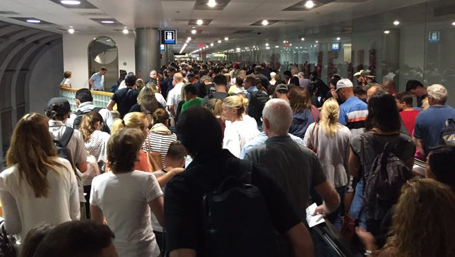 Travelers entering the United States at Miami International airport on Jan. 2, 2017. A four-hour outage of Customs and Border Protection's computer system caused long lines and frayed tempers.