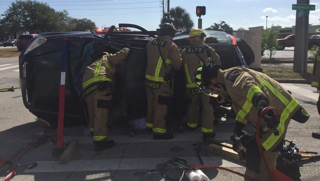 Two people suffered minor injuries when a car overturned on West New Haven Avenue in Melbourne.