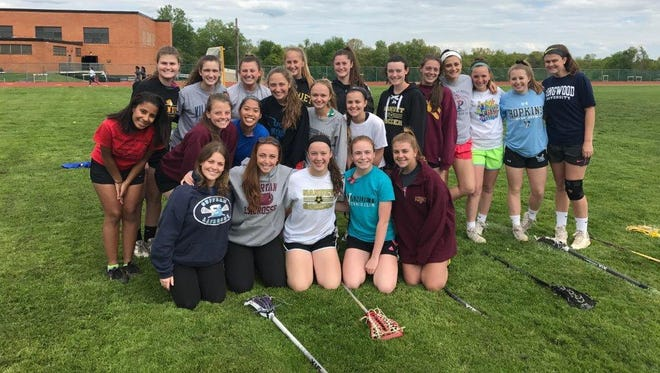 Courtney McGrath (front row, left) with her Nanuet girls lacrosse team.