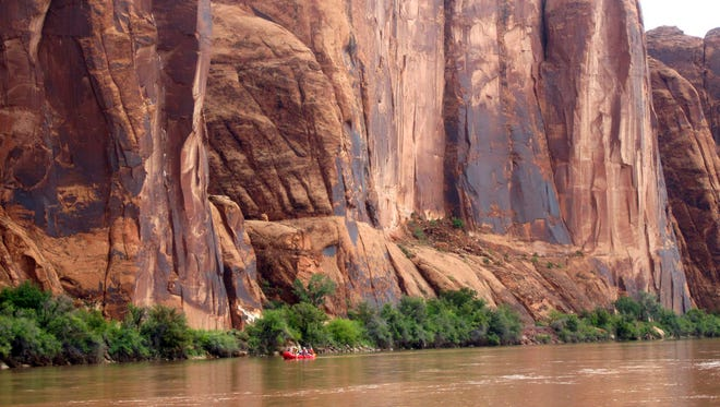 In this July 25, 2017, file photo, rafters float down the Colorado River near Moab, Utah. Rivers are drying up, popular mountain recreation spots are closing and water restrictions are in full swing as a persistent drought intensifies its grip on pockets of the American Southwest. Climatologists and other experts are scheduled Wednesday, May 23, 2018, to provide an update on the situation in the Four Corners region - where Arizona, New Mexico, Colorado and Utah meet.