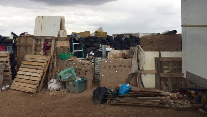 This Friday, Aug. 3, 2018, photo released by Taos County Sheriff's Office shows a rural compound during an unsuccessful search for a missing 3-year-old boy in Amalia, N.M. Law enforcement officers searching the compound for the missing child didn't locate him but found 11 other children in filthy conditions and hardly any food, a sheriff said Saturday. The children ranging in age from 1 to 15 were removed from the compound and turned over to state child-welfare workers, Taos County Sheriff Jerry Hogrefe said.in Taos.