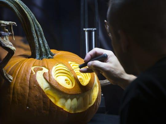 Pumpkin carver Ray Villafane goes eyeball to eyeball