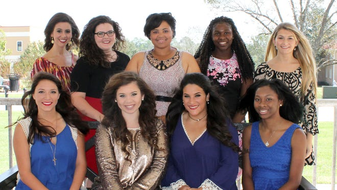 Freshman maids on the 2015 homecoming court at Pearl River Community College are, seated from left, Courtney Logan King of Columbia, Virginia Ellen Hall of Purvis, Cassady Marie Compretta of Bay St. Louis and Forrest County Center freshman maid Alexis Shacara Pickens of Hattiesburg; standing are sophomore maids Renelle Elena Failla of Picayune and Katherine Elise Johnson of Tylertown, Queen Michaela Aliss Andrews of Foxworth, Forrest County sophomore maid Demayah Johnson of Hattiesburg and Hancock Center maid Maranda Dawn Bennett of Pearlington.