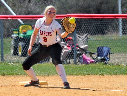 Haley Williamson catches the ball at first base last
