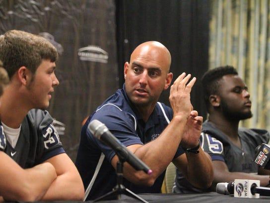Maclay coach Lance Ramer jokes around with his players