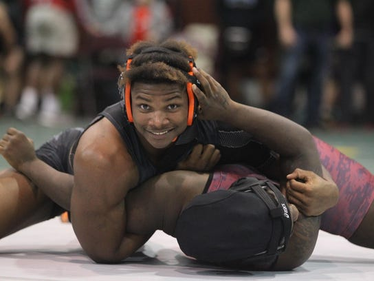 Cam Brown smiles for the camera while calmly pinning