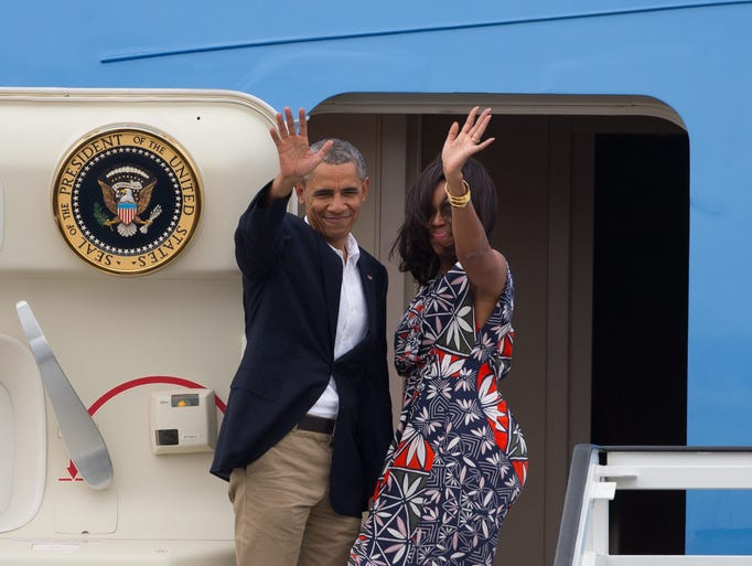 President Obama and First Lady Michelle Obama wave