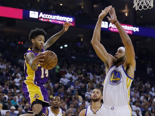 Los Angeles Lakers' Brandon Ingram, left, looks to pass under the basket as Golden State Warriors' JaVale McGee (1) defends during the first half of an NBA basketball game Wednesday, April 12, 2017, in Oakland, Calif. (AP Photo/Marcio Jose Sanchez)