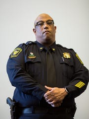 Cincinnati's Chief of Police Eliot Isaac listens to
