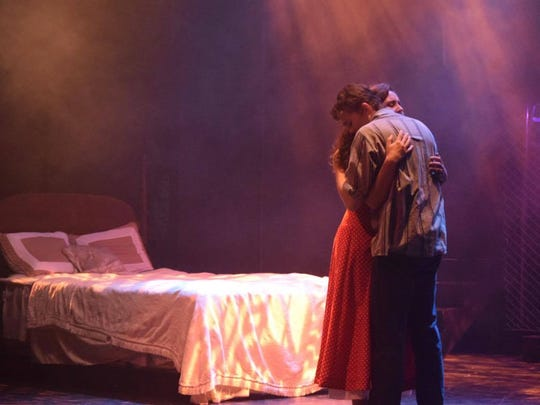 "Maria (Carolyn Hall) and Tony (Alex Furlong) share an embrace in Theatre Tallahassee's moody take on ""West Side Story"""