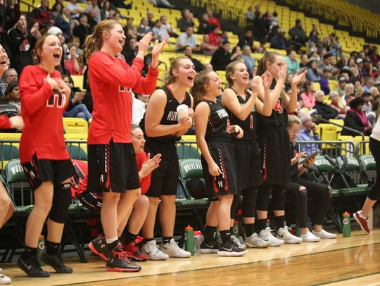 Hurricane's bench celebrates during its 53-44 win over