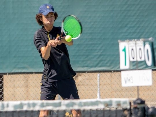 Ventura High junior Max Cohen hits a backhand during a singles match in the Cougars' first-round playoff win Wednesday. Cohen and Noah Laber won the Channel League doubles title.