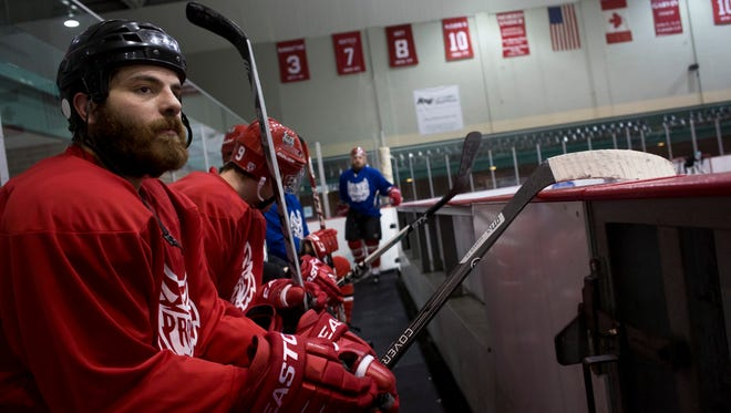 Port Huron Prowlers forward Ahmed Mahfouz watches from the bench with his teammates during practice Tuesday, November 24, 2015 at McMorran Arena.