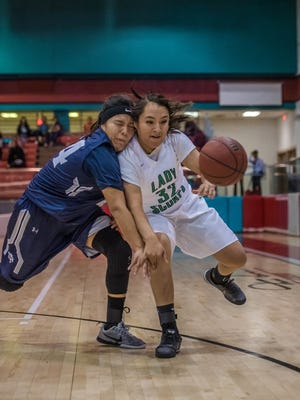 Piedra Vista's Kristi Lee Bennie, left, and Farmington's Lyla Denny battle for a loose ball on Thursday at the Chieftain Pit in Shiprock.