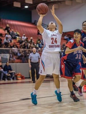 Shiprock's Tierra Clichee makes a layup against Red Mesa, Ariz., on Thursday at the Chieftain Pit in Shiprock.
