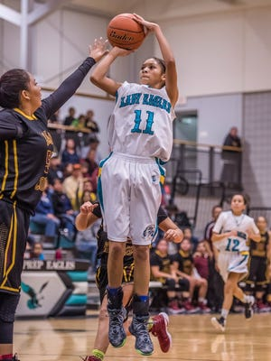 Navajo Prep's Martinique Larvingo pulls up for a jump shot against Tohatchi on Thursday at the Eagles Nest.