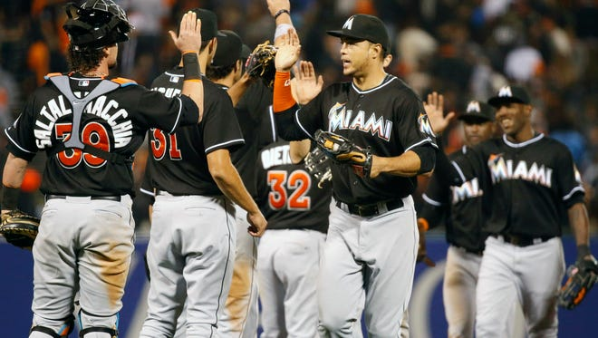 The Miami Marlins celebrate after the final out during the ninth inning against the San Francisco Giants at AT&T Park.