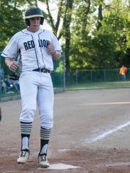 Red Lion's Tyler Taylor touches home plate during a
