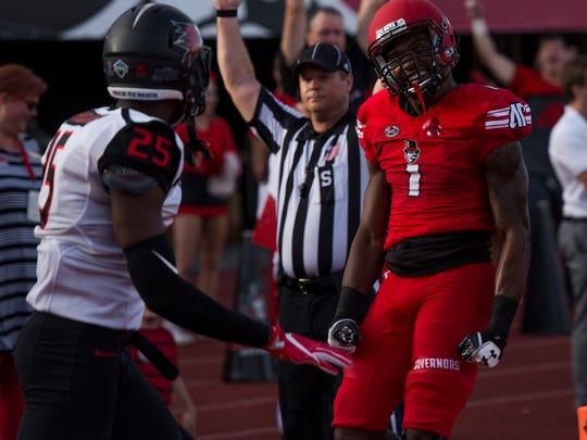 DJ Montgomery, 1, reacts to scoring a touchdown for