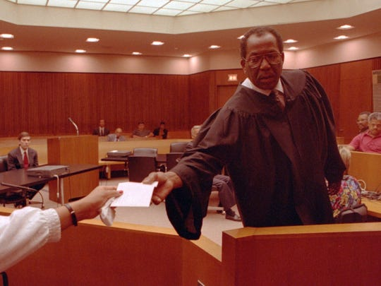 Judge George Crockett III receives the sealed verdict from the foreperson of the Budzyn jury on Saturday afternoon.  8/21/93