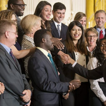 President  Obama shakes hands with participants after