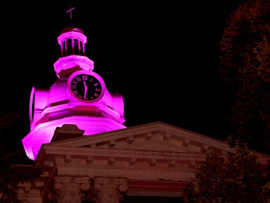 The Rutherford County Courthouse is lit purple because