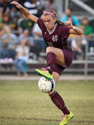 Henderson Katie Bickers tries to control the ball as the Henderson County Lady Colonels play University Heights in the Second Region Girls Soccer Tournament semi-final at Colonel Field Wednesday, October 19, 2016.