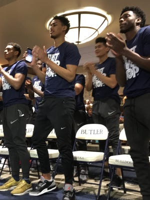 Butler players react to seeing the Bulldogs' inclusion in the NCAA tournament during the selection show. From left are Aaron Thompson, Jordan Tucker, Christian David (second row) and Kamar Baldwin.