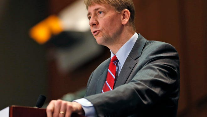 Consumer Financial Protection Bureau Director Richard Cordray speaks during a March 2015 panel discussion in Richmond, Virginia.