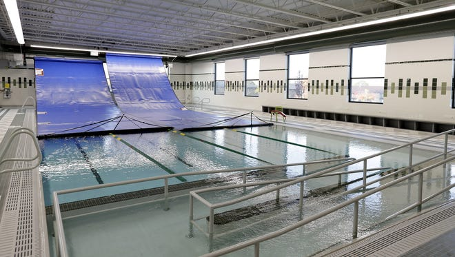 The warm water activity pool at the new Aquatic Center at Ashwaubenon High School, with the retractalbe covers pulled back.