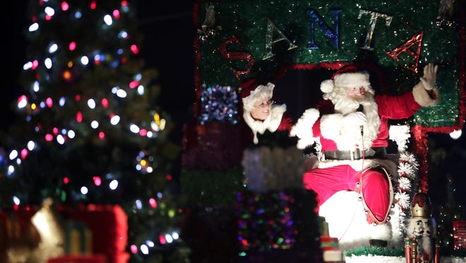 Santa and Mrs. Claus wave to the crowd from their float during last year's Downtown Appleton Christmas Parade. The parade is back on Tuesday.