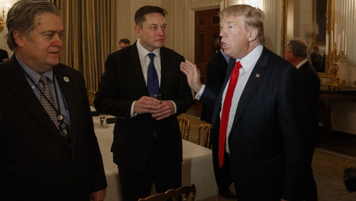 File photo taken on Feb. 3, 2017 shows President  Trump talking with Tesla and SpaceX CEO Elon Musk, center, and White House chief strategist Steve Bannon during a White House meeting with business leaders.