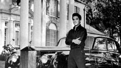 Elvis Presley and his Rolls Royce in October 1960.