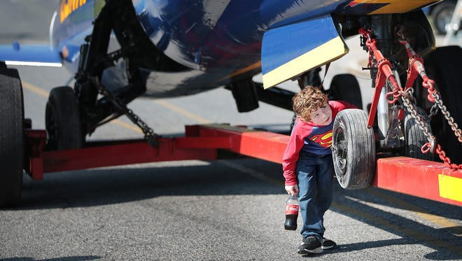 Ayden Barrett, 7, gets a close look at Millington's Blue Angel while in transit back to it's home at the Millington airport Saturday Jude 2, 2018. The F-11 has greeted visitors to the Navy Base since 1975, and is returning after the completion of a paint and restoration project at a Memphis auto body shop.