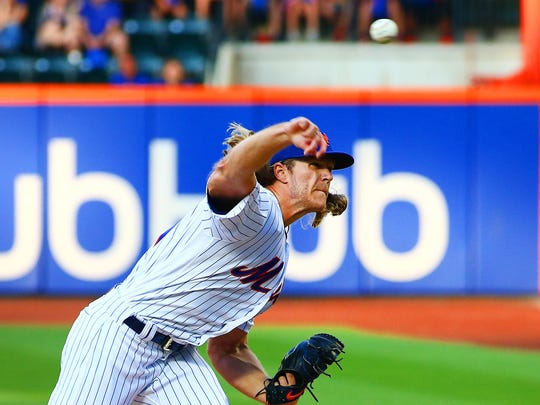 New York Mets starting pitcher Noah Syndergaard (34) pitches against the Washington Nationals during the first inning at Citi Field.