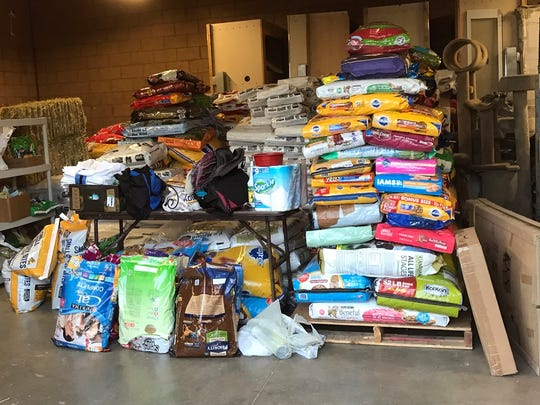 "Donated animal food is piled up at the Camarillo Animal Shelter. Marketing director Randy Friedman said the community has donated ""literally a ton of food"" for the animals in the wake of the Thomas Fire."