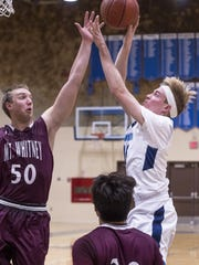Redwood's Nathan Treece shoots over Mt. Whitney's Andrew