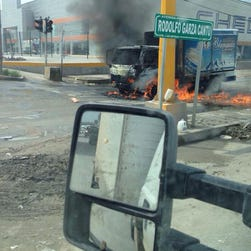 A truck blazes on a street of Reynosa, Tamaulipas state, Mexico on April 17, 2015. Gunfights erupted in broad daylight on Friday in a Mexican city across the US border and vehicles were torched, apparently in reaction to a drug cartel leader's arrest, officials said.