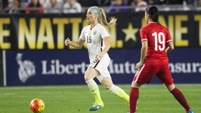 U.S. women's national team defender Julie Johnston brings the ball up against China P.R. midfielder Tan Ruyin during the first half of a friendly at University of Phoenix Stadium in Glendale December 13, 2015. The game was part of the national team's victory tour after winning the World Cup in Canada.