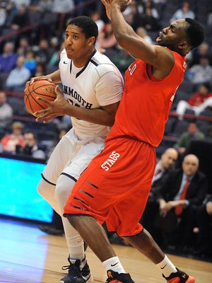 Monmouth's Zac Tillman, left, is guarded by Fairfield's Jonathan Kasibabu in a match during the MAAC semifinals at the Times Union Center on Sunday, March 6, 2016 in Albany, N.Y. (Lori Van Buren)