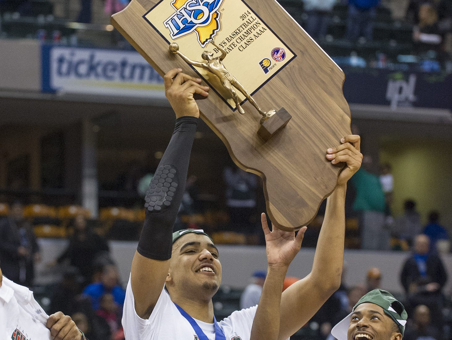 FILE – Tech's Trey Lyles (41) holds up the team's State Championship trophy after winning the IHSAA Boys Basketball 4A State Finals at Bankers Life Fieldhouse, March 29, 2014.