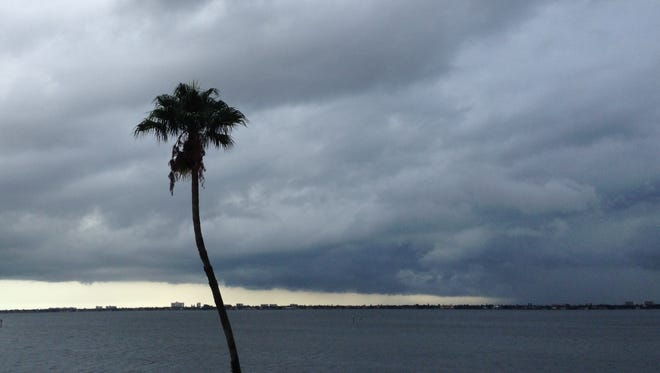 Clouds roll over the Indian River in Melbourne as rain moves into the area from the south. Melbourne has not seen rainfall at the official NWS recording station for more than a month.