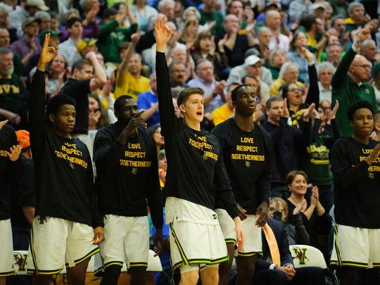 The Vermont bench celebrates a 3-pointer during the men's basketball game between the Binghamton Bearcats and the Vermont Catamounts at Patrick Gym last season.
