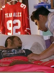 Alex Fernandez, left, gets a visit from his step-brother,