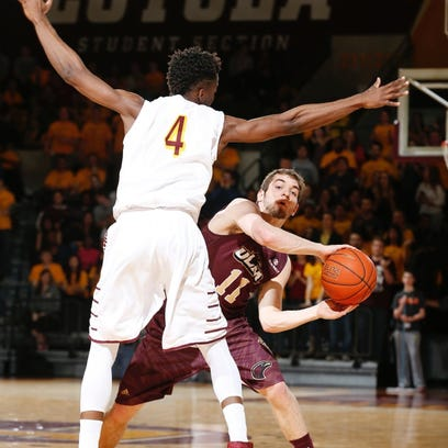 ULM's Nick Coppola looks to make a pass against Loyola-Chicago