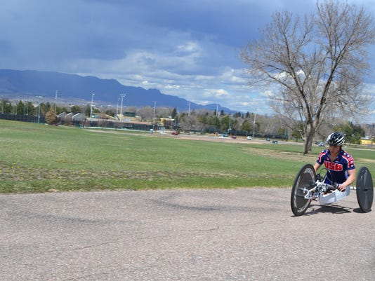 In this April 12, 2016 photo, Paralympian Oksana Masters rides her hand-cycle during training at the Olympic Training Center, in Colorado Springs, Colo. Masters was adopted out of a Ukrainian orphanage by an American woman nearly two decades ago. The malnourished Masters had birth defects believed to be from the aftermath of Chernobyl and on the 30th anniversary of world's worst nuclear accident, Masters can't help but think about how far she's traveled. (AP Photo/P. Solomon Banda)