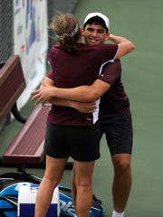 Corpus Christi London's Dillon Humpal gets a hug from coach Melinda Westcott after winning  the Class 3A boys singles state championship match over Brady's John Jack Marshall at the UIL State Tennis Championships on Thursday, May 18, 2017, at the George P. Mitchell Tennis Center in College Station. Humpal won the match 6-1, 7-6(5).