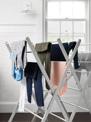 Hanging white clothes outside in the sun can help keep them bright. However, dark items are best hung up to dry indoors, to keep the colors from fading.