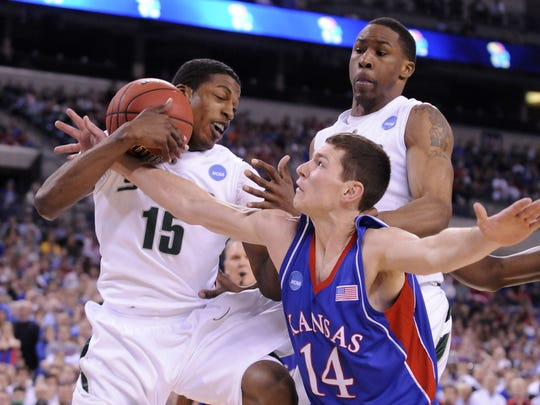 MSU's Durrell Summers pulls a rebound away from Kansas'